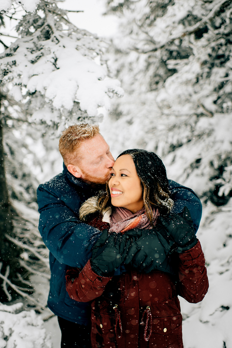 Couple posing during their family photoshoot at Hurricane Ridge
