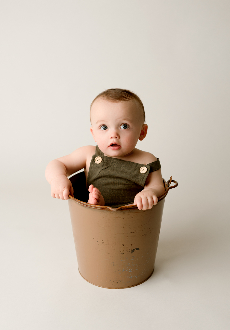 baby sitting in a bucket