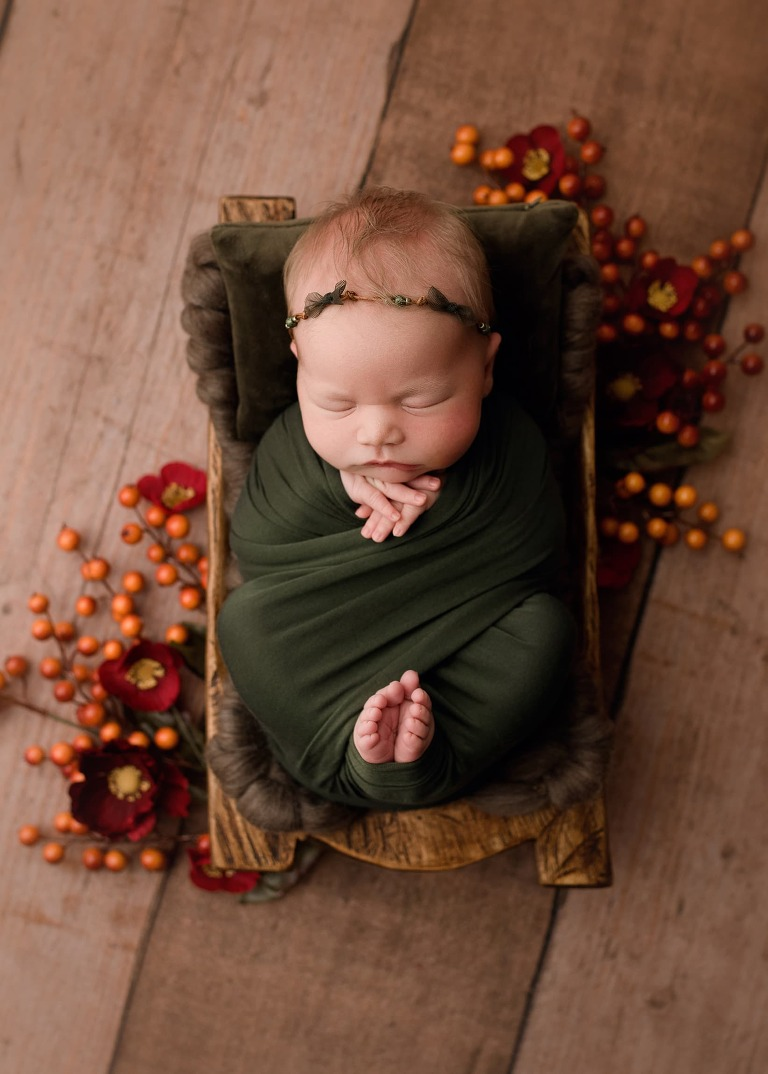Baby Girl Posed During Newborn Session in a Studio