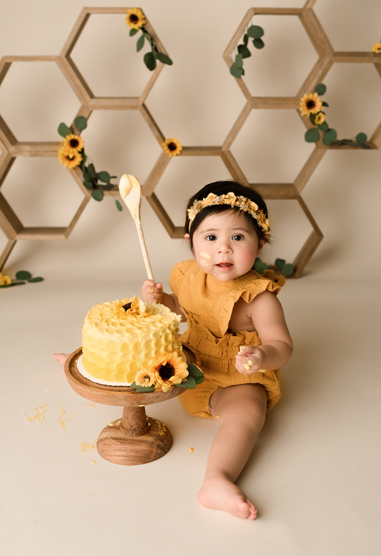 Baby eating cake during her 1st birthday photo session