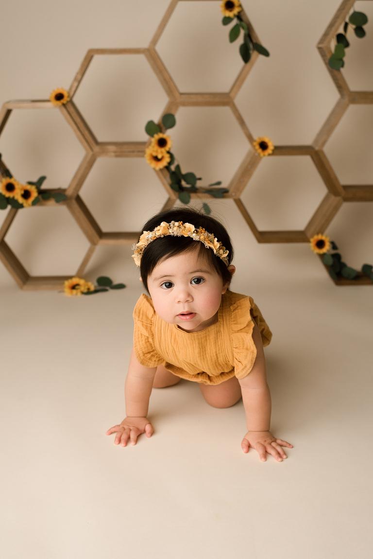 Baby wearing yellow romper